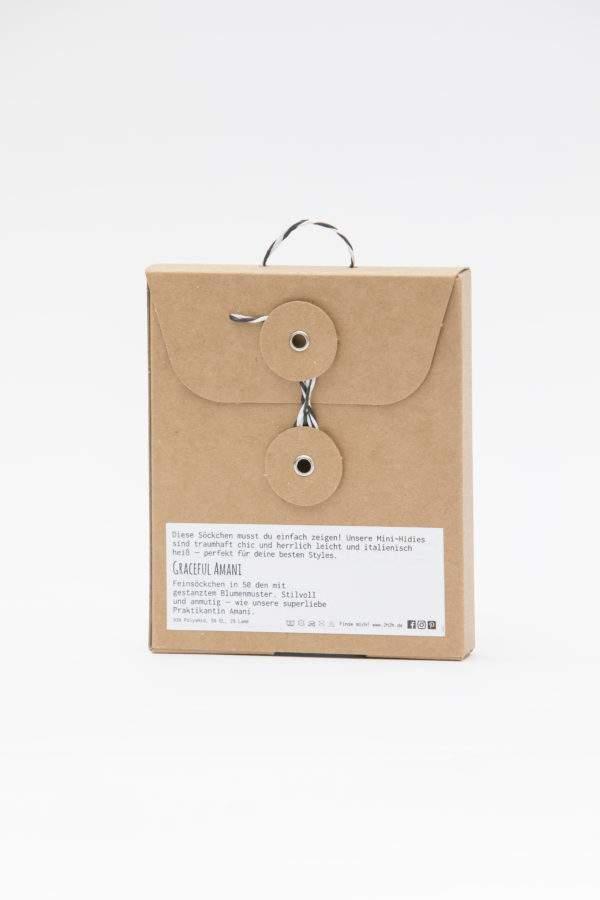 Verpackung Graceful Amani white: 50 den Söckchen mit gestanzten Blümchen und Lurex-Bündchen